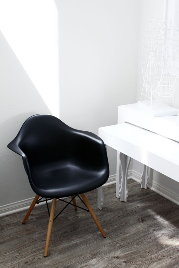 eames style daw molded in black plastic dining armchair with wood